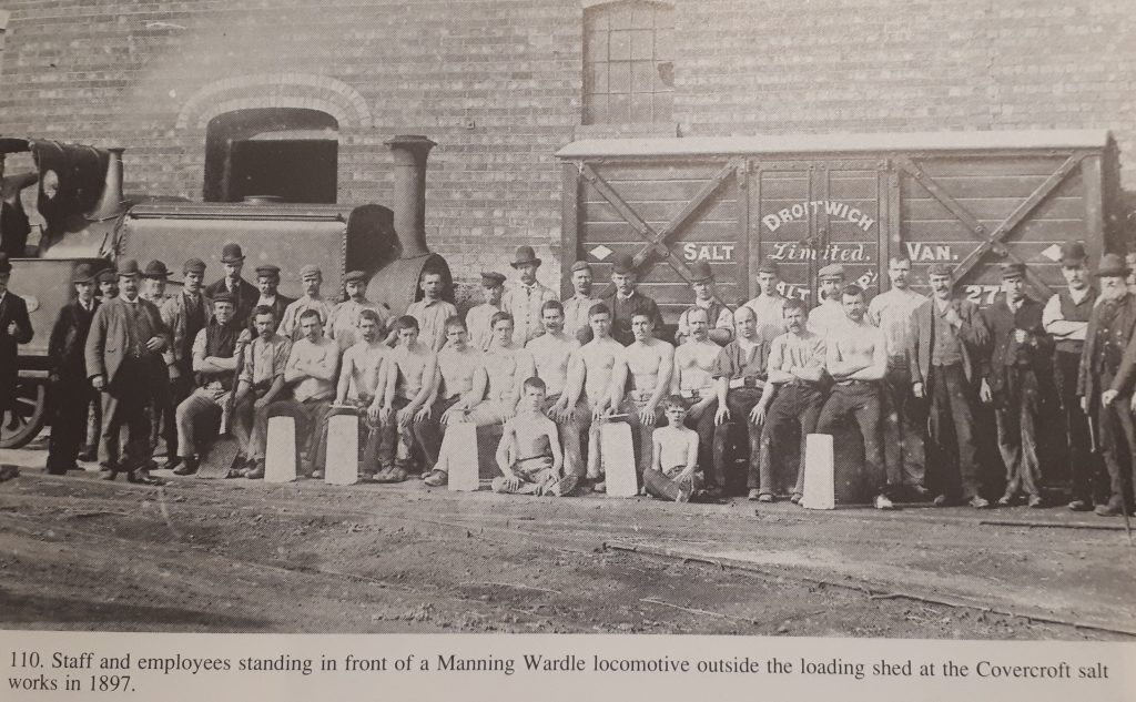 Staff and Employees standing in front of Manning Wardle locomotive outside loading shed at Covercroft salt works 1897.